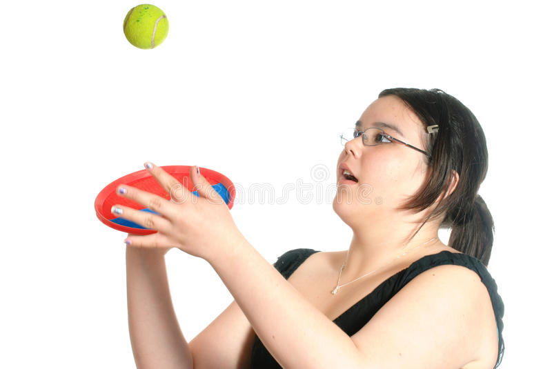 Catch. Young preteen girl playing catch with a Hook and Loop Fastener mitt and ball, isolated against a white background royalty free stock photos