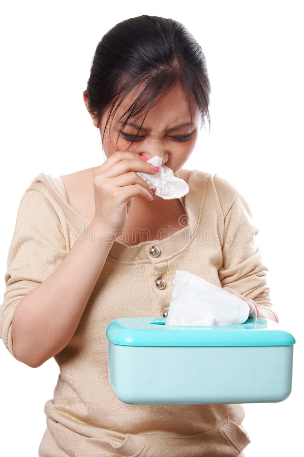 Catch a cold. Woman catch a cold, blowing her nose with tissues, isolated on white royalty free stock photo
