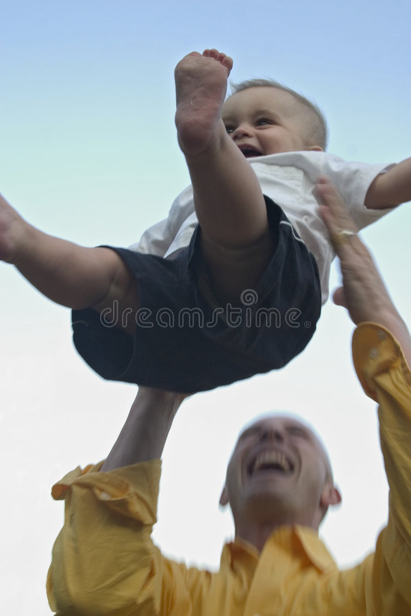 Download Catch Me Daddy_2 stock image. Image of toss, daddy, father - 228225