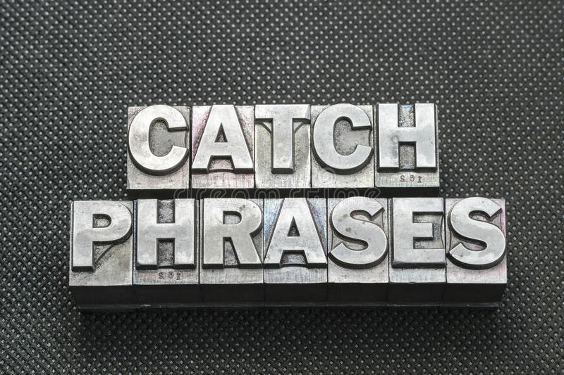 Catch phrases bm. Catch phrases made from metallic letterpress blocks on black perforated surface stock images
