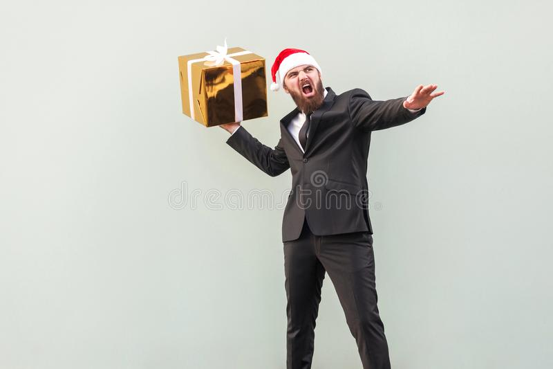 Catch your gift! Young adult well dressed bearded man swung and royalty free stock photos