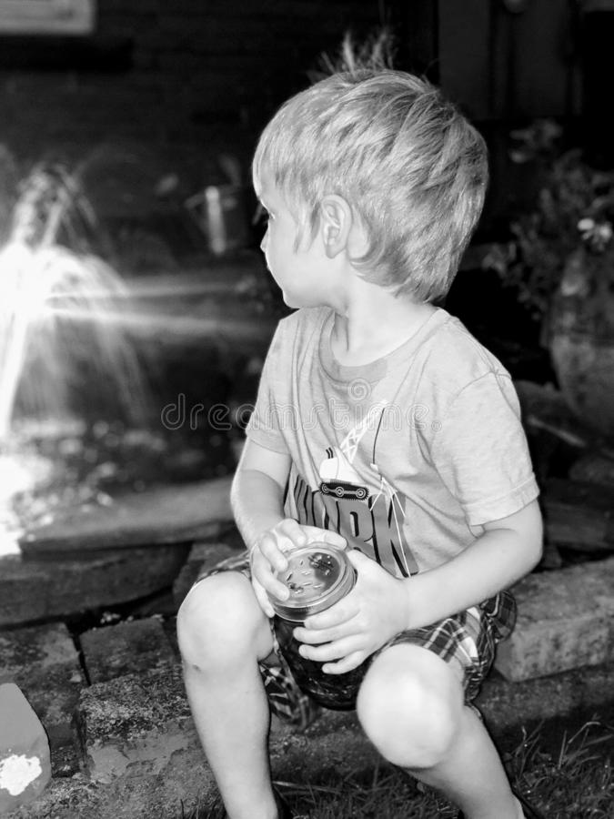 Catching fireflies black and white. Waterfountain stock image