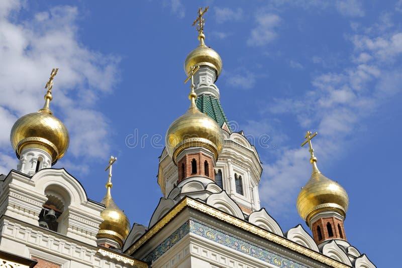 A catedral de São Nicolau, Viena, com suas cebolas da torre do ouro imagens de stock royalty free