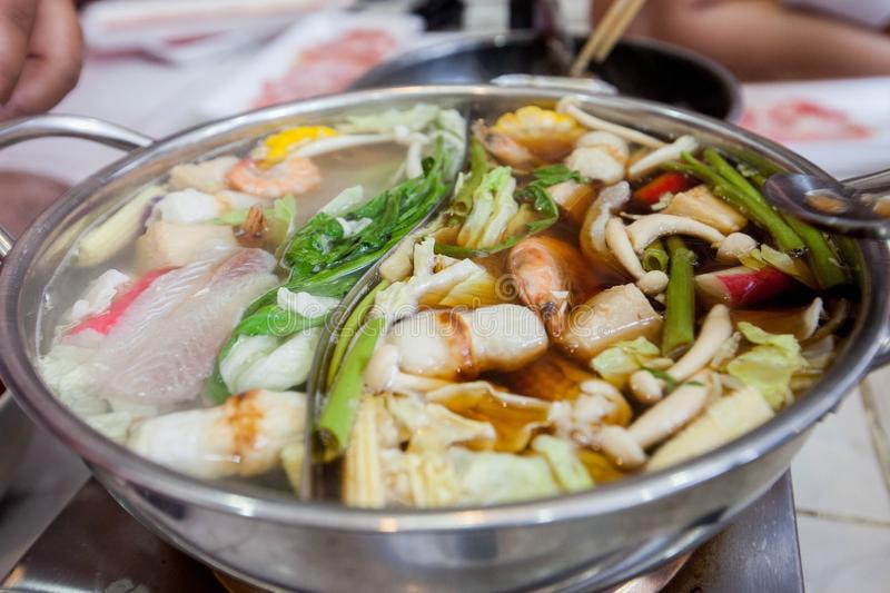 Category of foods hot pot .Food on the stove. Category of foods hot pot .Food on Electric stove. thai hot pot stly. Includes shrimp, fish, beef, vegetables royalty free stock photo