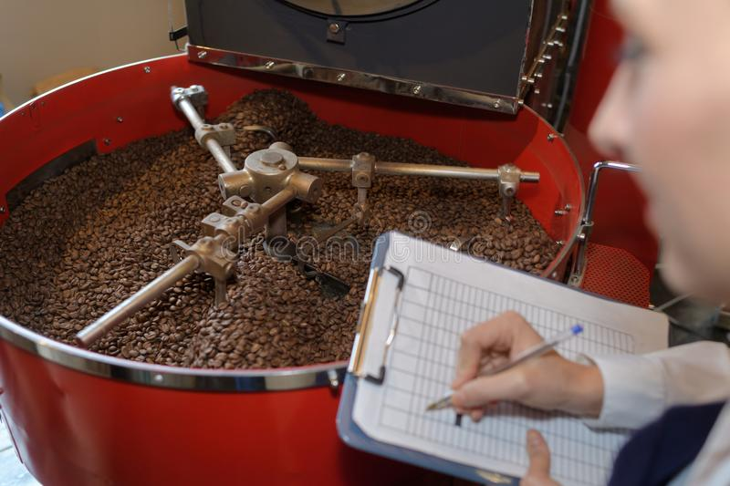 Category manager inspecting coffee. Category manager inspecting the coffee royalty free stock photos