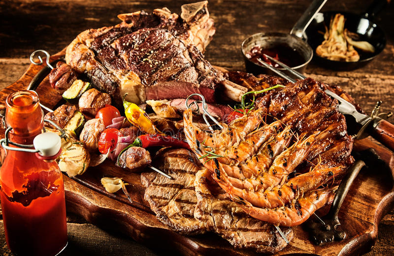 Catered barbecue meat served on table stock image