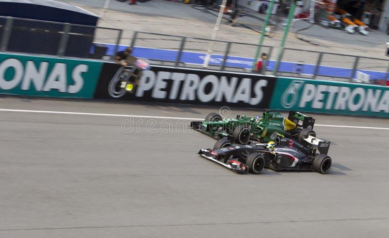 Sauber Ferrari overtakes Caterham F1 team royalty free stock photography