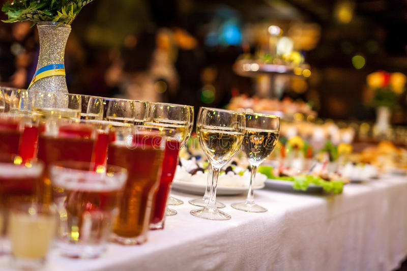 Catering banquet table, catering, buffet, canapés, stemware, glasses with juice, champagne glasses, glasses with wine stock photo