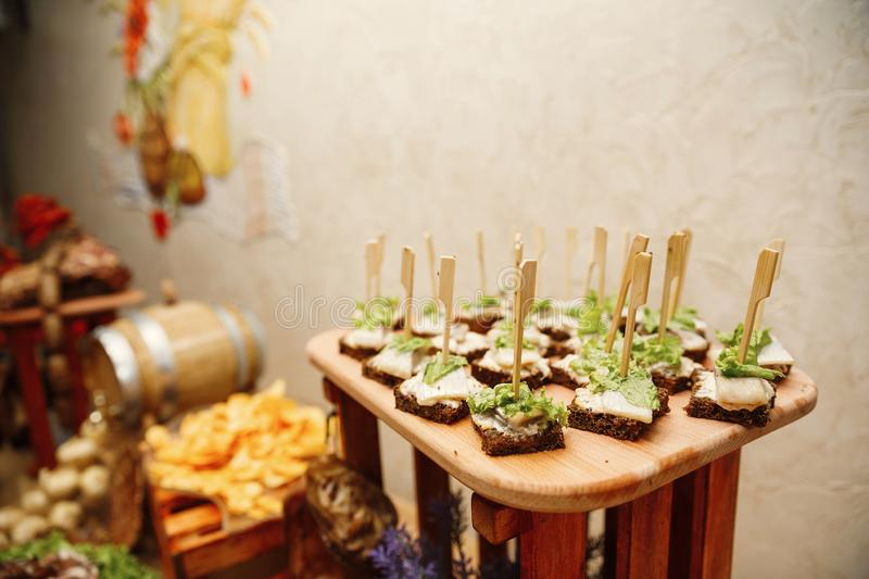 Catering banquet table with different food snacks and appetizers stock images