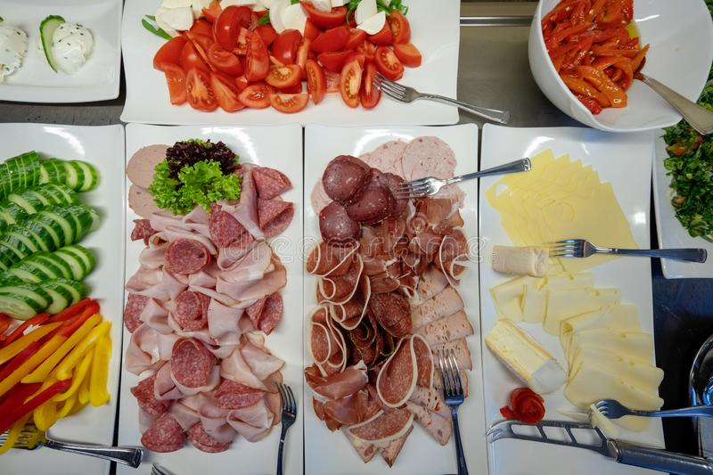 Catering buffet food indoor in luxury restaurant with meat, cheese and sausage stock photos