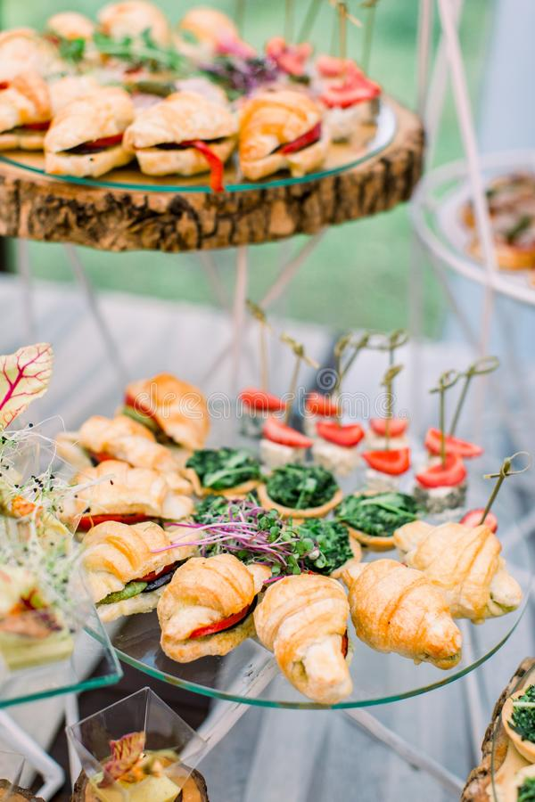 Catering buffet and rustic decor, outdoor wedding party with healthy food snacks.  stock photos
