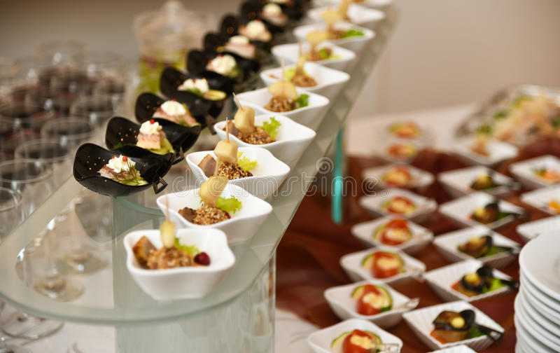 Catering, cold snacks assortment stock photos