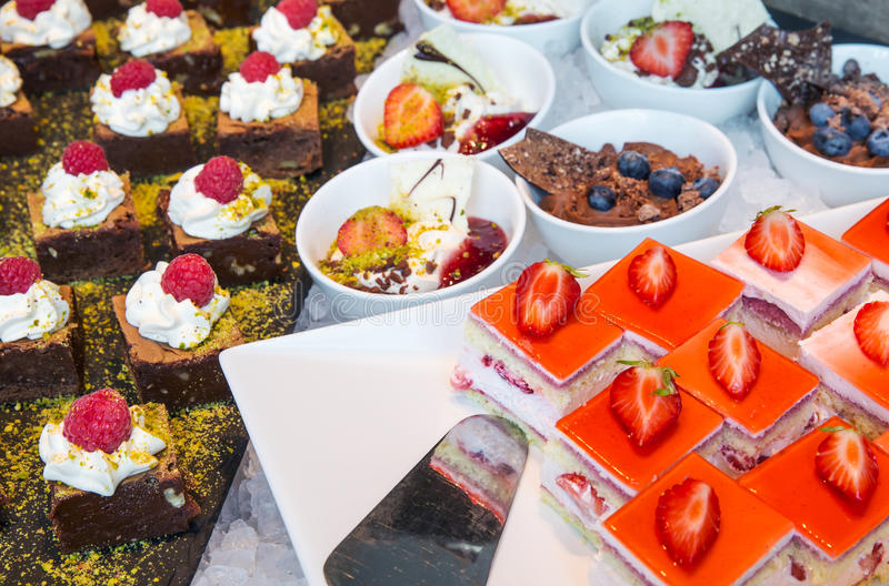 Catering desserts. A table filled with a variety of desserts royalty free stock photos