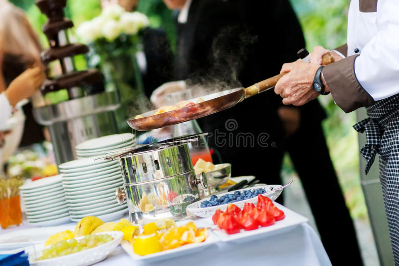 chef is cooking fruit stock photography