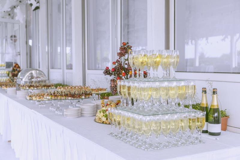 Catering at the event, poured into glasses of champagne, a beautifully decorated table with snacks stock photos