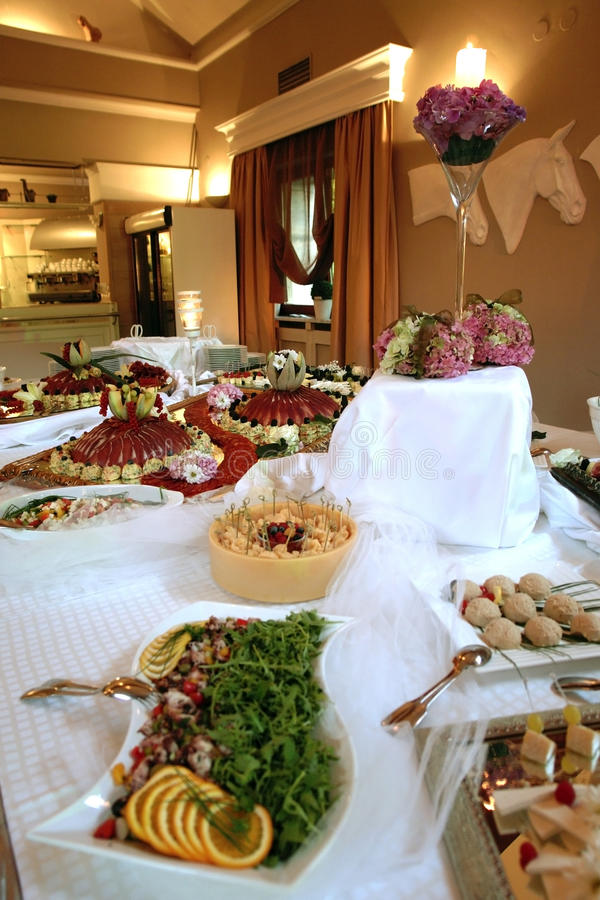 Catering food. Table filled with food and goodies at the wedding party royalty free stock images