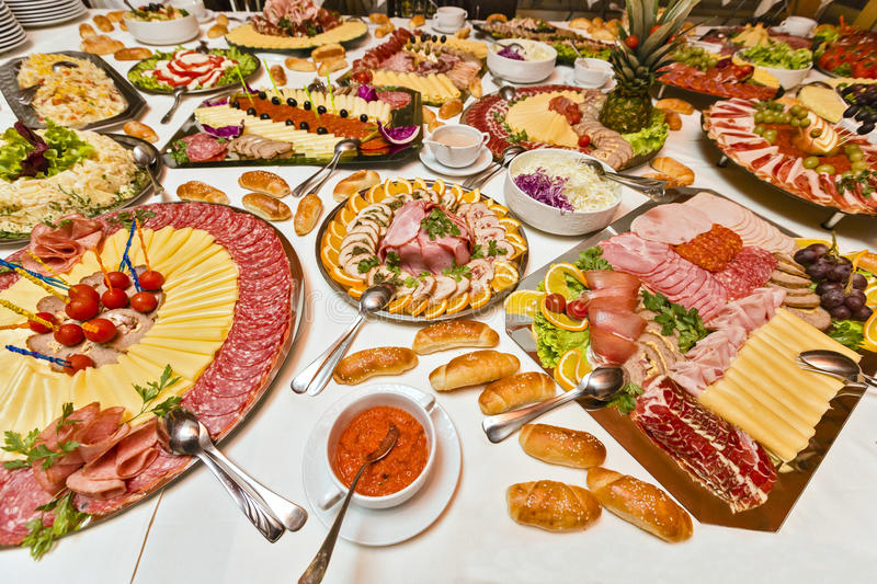 Catering food. Table filled with numerous types of tasty, catering food stock photo