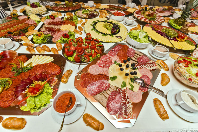 Catering food. Table filled with numerous types of tasty, catering food royalty free stock photo
