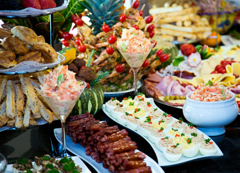 Catering food. Divers catering food at a party royalty free stock images