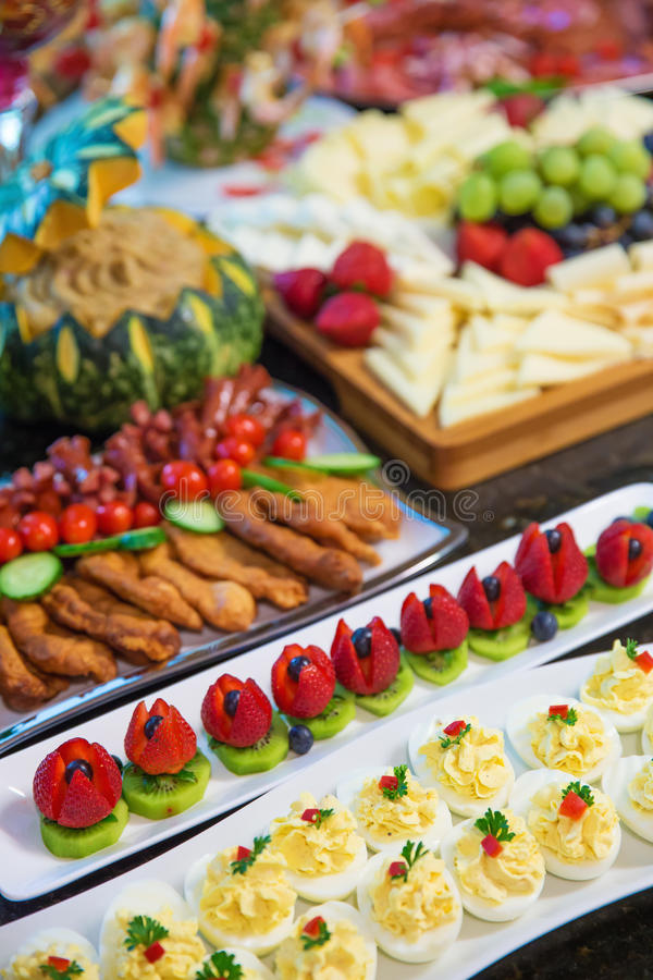 Catering food. Divers catering food at a party royalty free stock photography