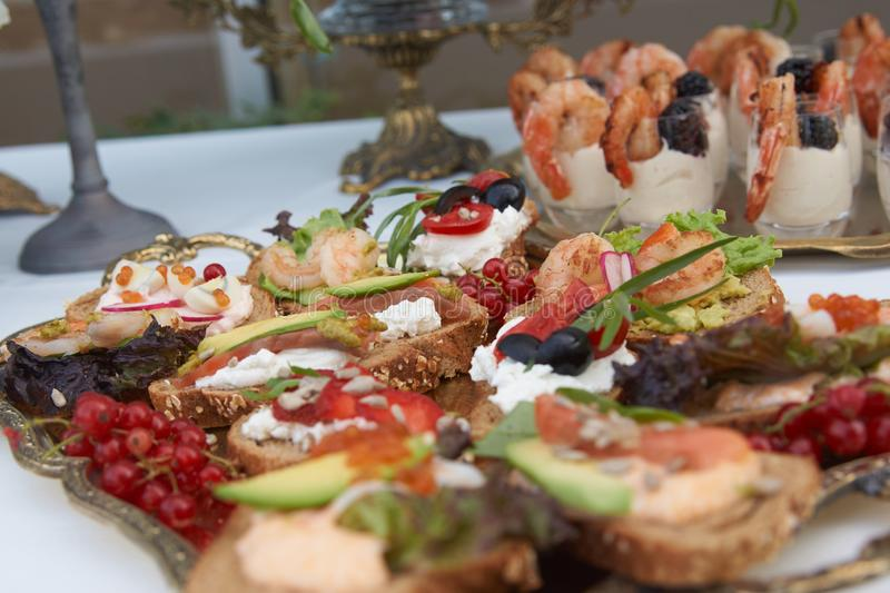 Catering service. Restaurant table with buffet food stock photos