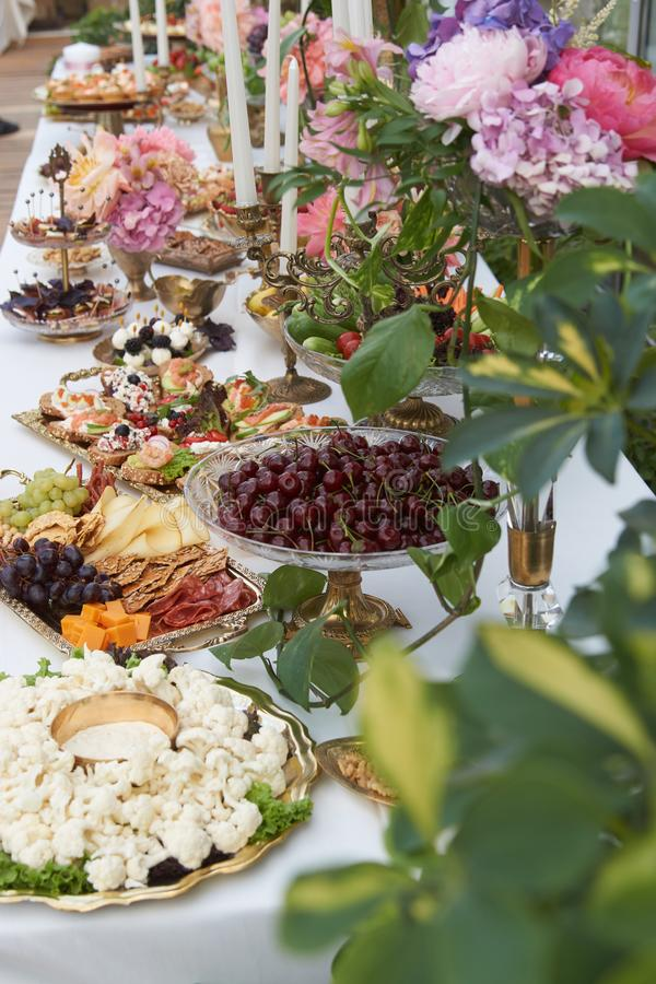 Catering service. Restaurant table with buffet food royalty free stock photo