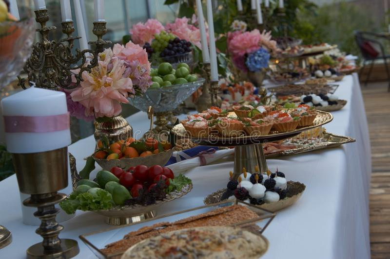 Catering service. Restaurant table with buffet food royalty free stock image