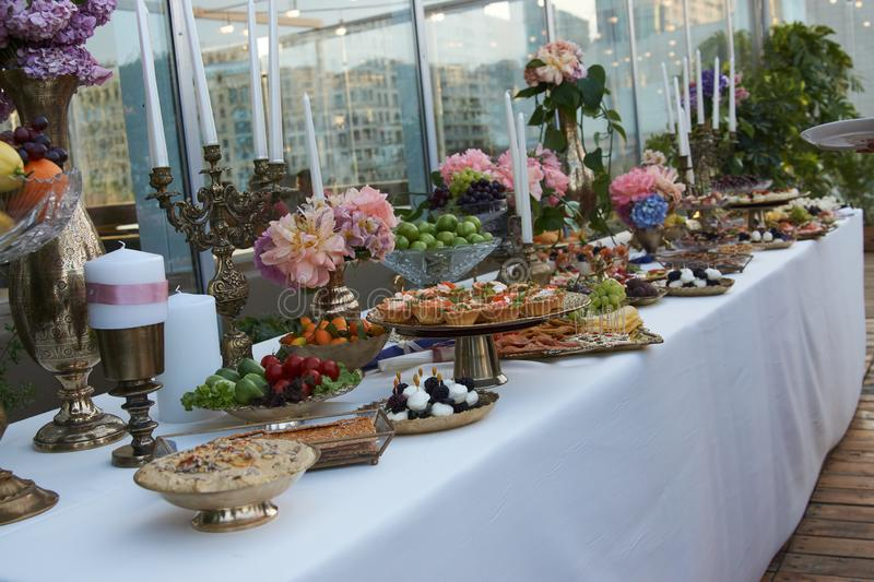 Catering service. Restaurant table with buffet food stock images