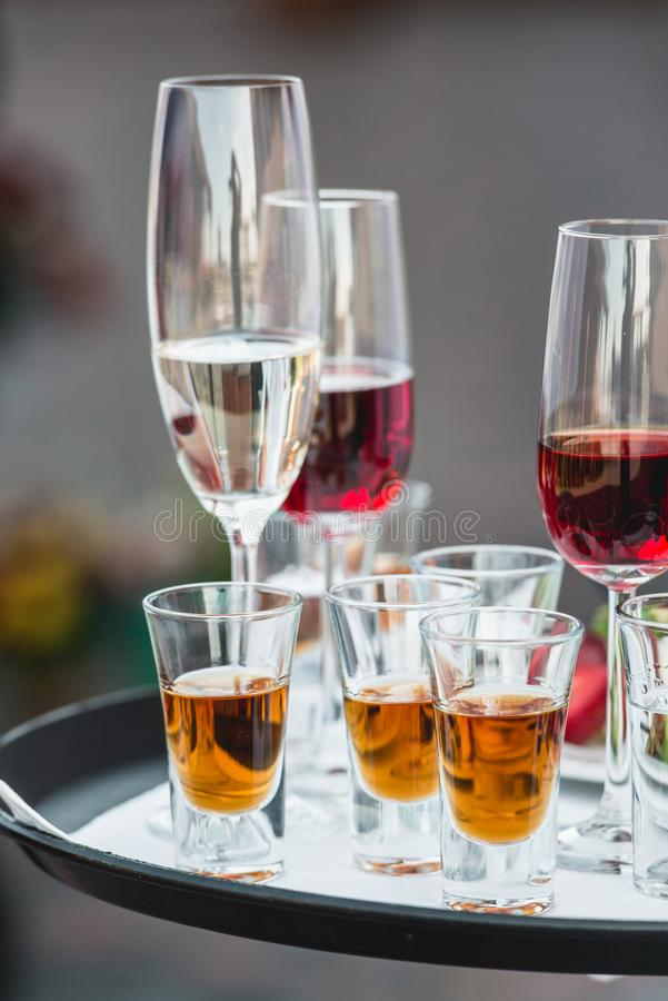 Catering services. Celebration. glasses with alcohol on a tray. stock photos