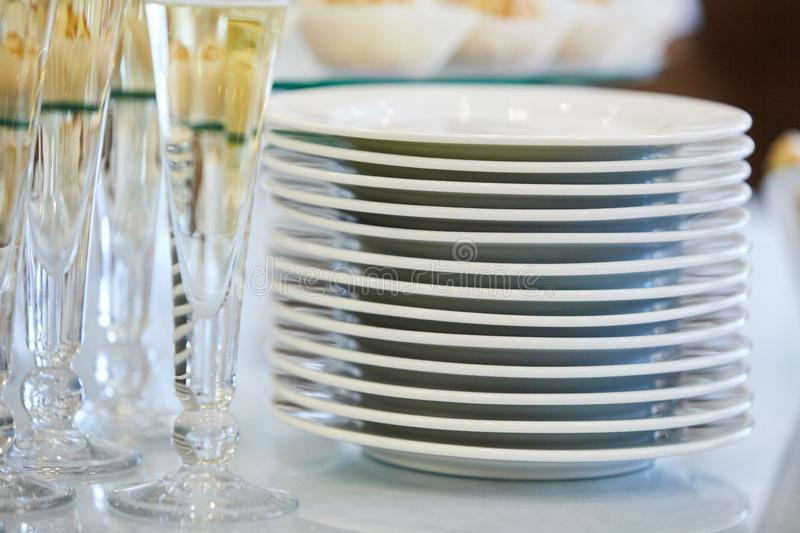 Catering services. Glasses with wine in row background at restaurant party. stock photos