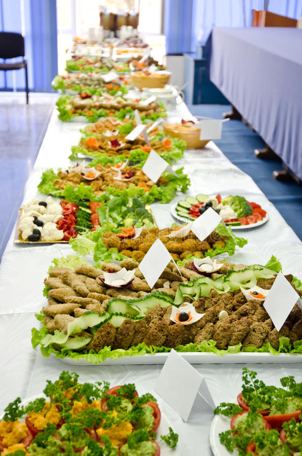 Catering table full of appetizing foods. Beautifully decorated trays with vegetarian food. Vegan food exposition and contest stock photo