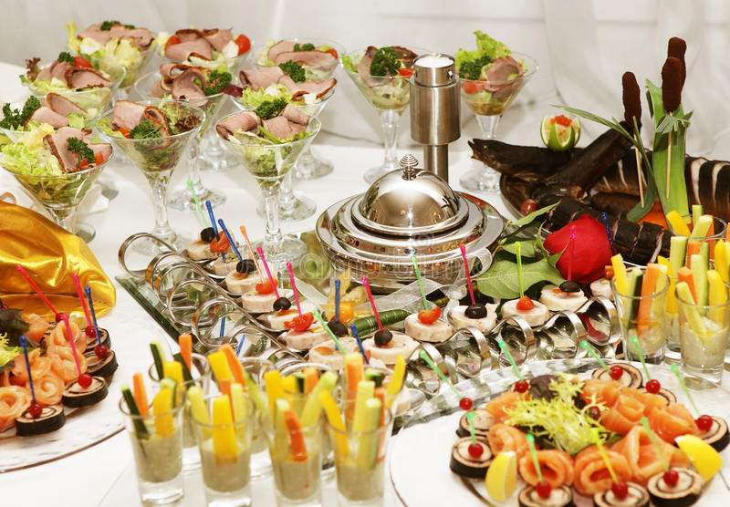 Catering table full of appetizing foods stock photo
