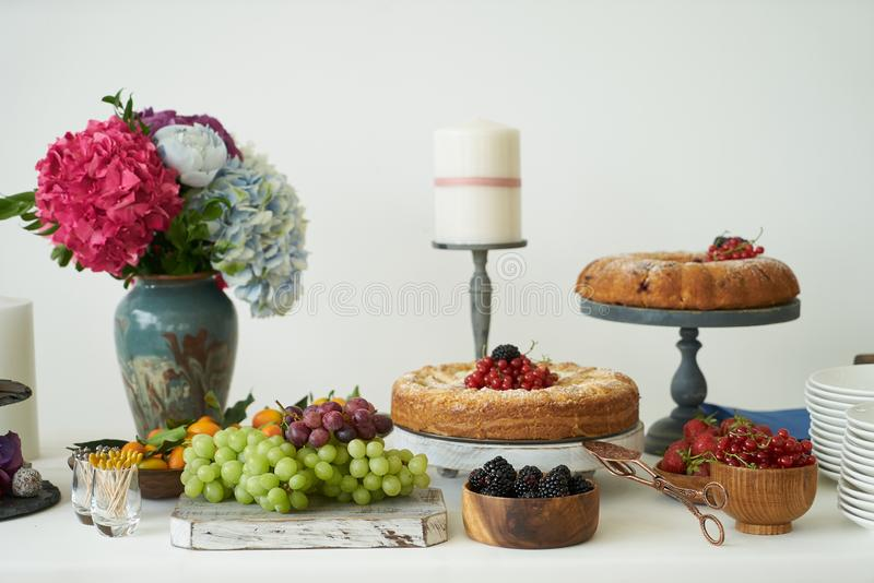 Catering wedding buffet for events. Dessert table in restaurant stock image