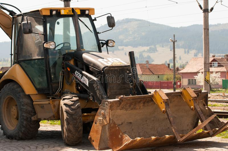 Caterpillar bulldozer near rail road track. Close up on a bright sunny day stock images