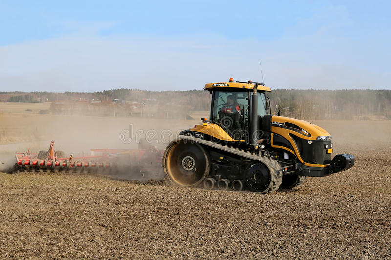 Caterpillar Challenger Crawler Tractor and Cultivator stock images