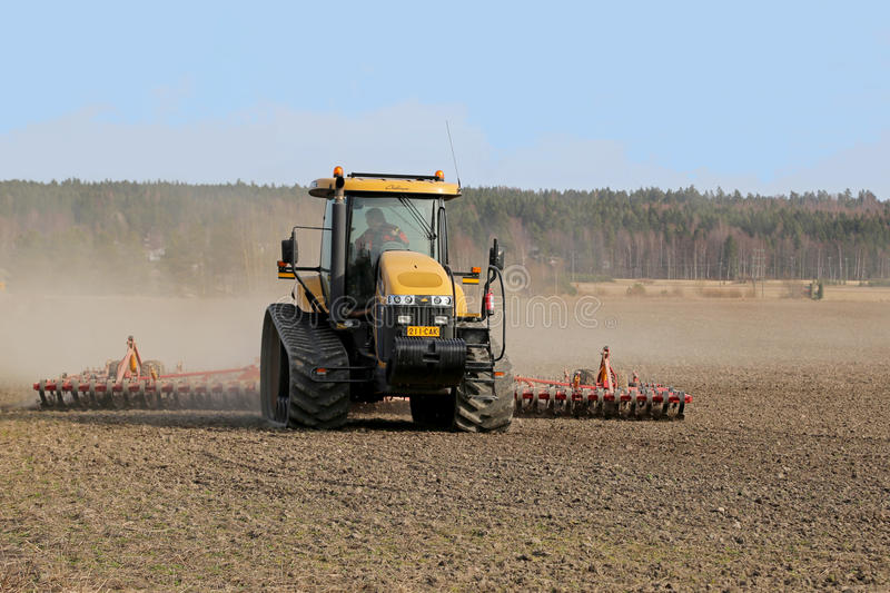 Caterpillar Challenger Crawler Tractor and Seedbed Cultivator stock photo
