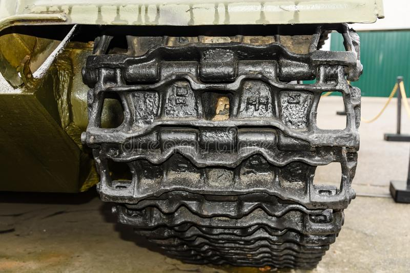 Caterpillar of a military tank or excavator. Close-up photo stock photo