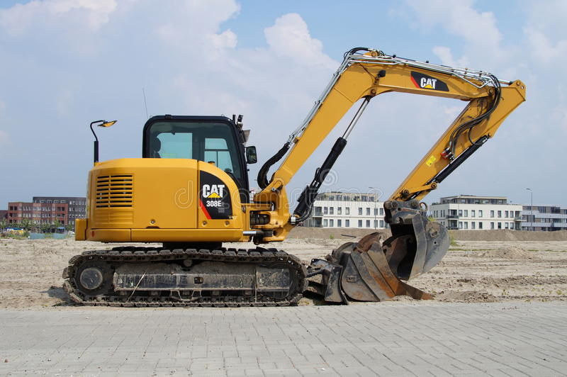Caterpillar 349E Backhoe Parked In Mud Editorial Photo - Image of