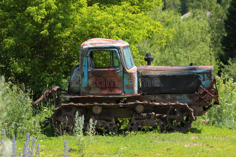Caterpillar tractor. Old caterpillar tractor in forest royalty free stock photos