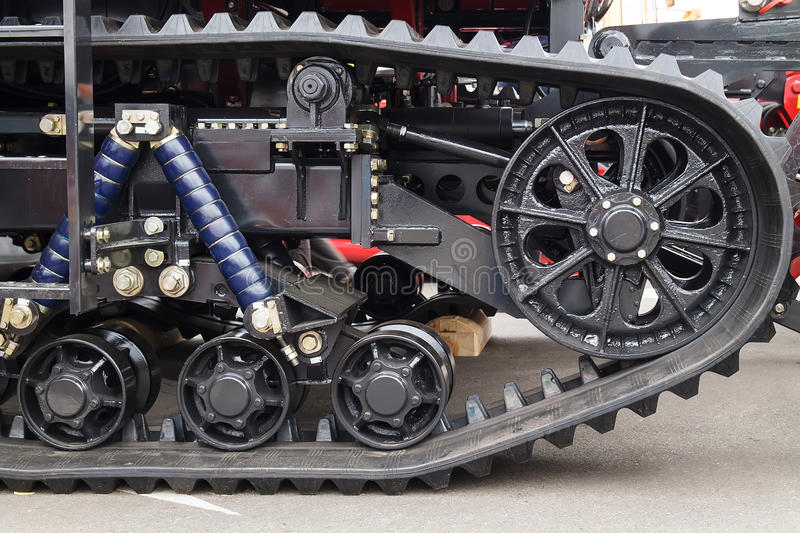Caterpillar tractor close-up. Chassis tractor caterpillar black close-up stock image
