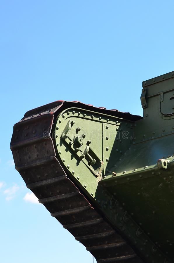 Caterpillars of the green British tank of the Russian Army Wrangel in Kharkov against the blue sk. Y stock photos