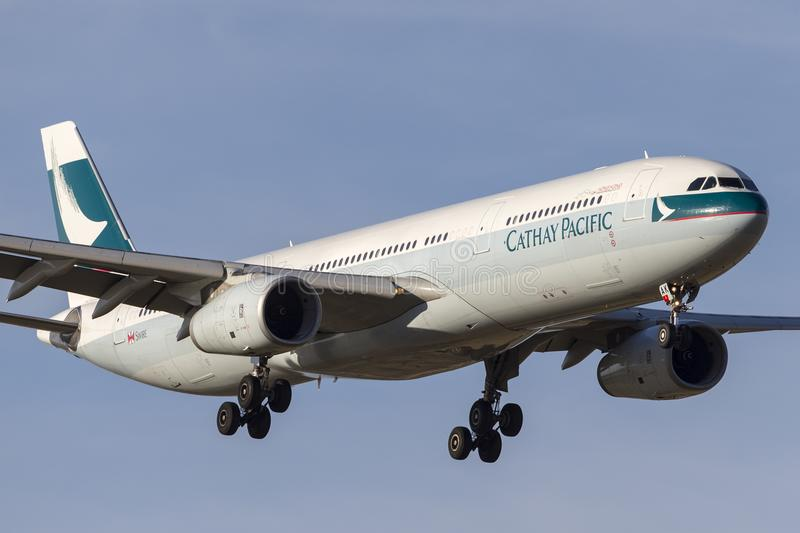 Cathay Pacific Airbus A330-343 airliner B-LAK on approach to land at Melbourne International Airport. royalty free stock photos