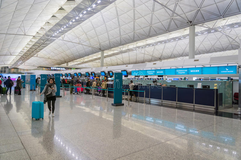 Cathay Pacific check-in counter area inside of Hong Kong International Airport. stock image