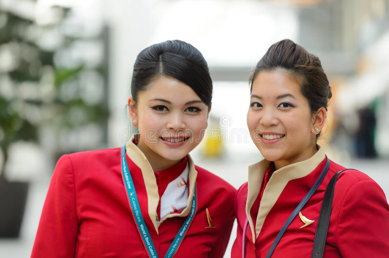 Cathay pacific crew members posing in airport editorial image image 59875075 - Cathay pacific head office ...