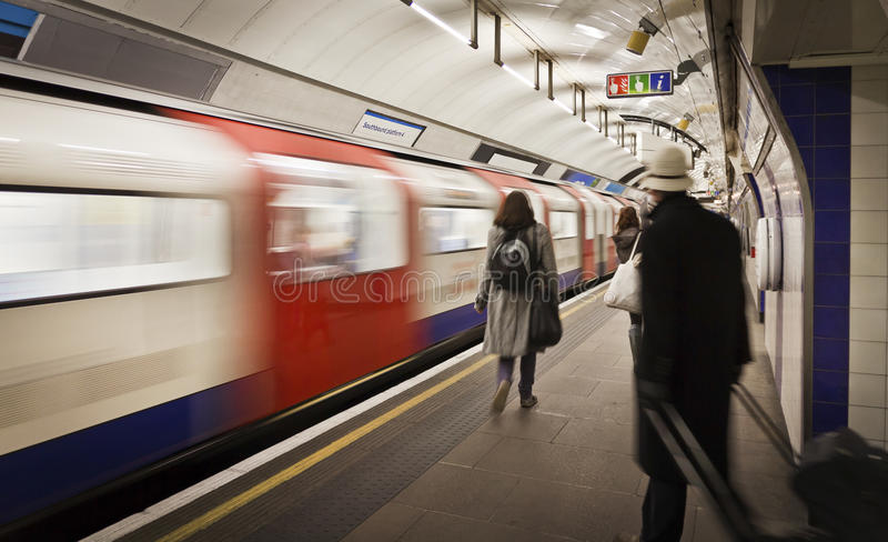 Cathcing the tube. Subway station in London, UK royalty free stock photo