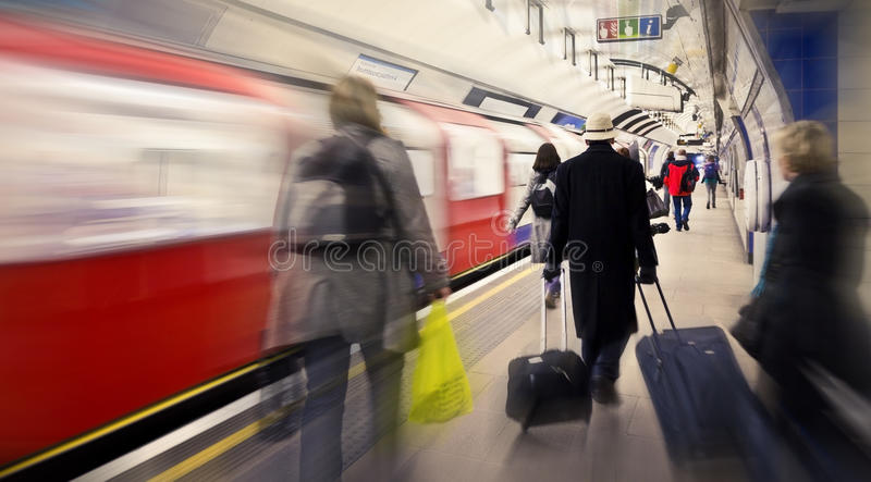 Cathcing the tube. Subway station in London, UK stock photos