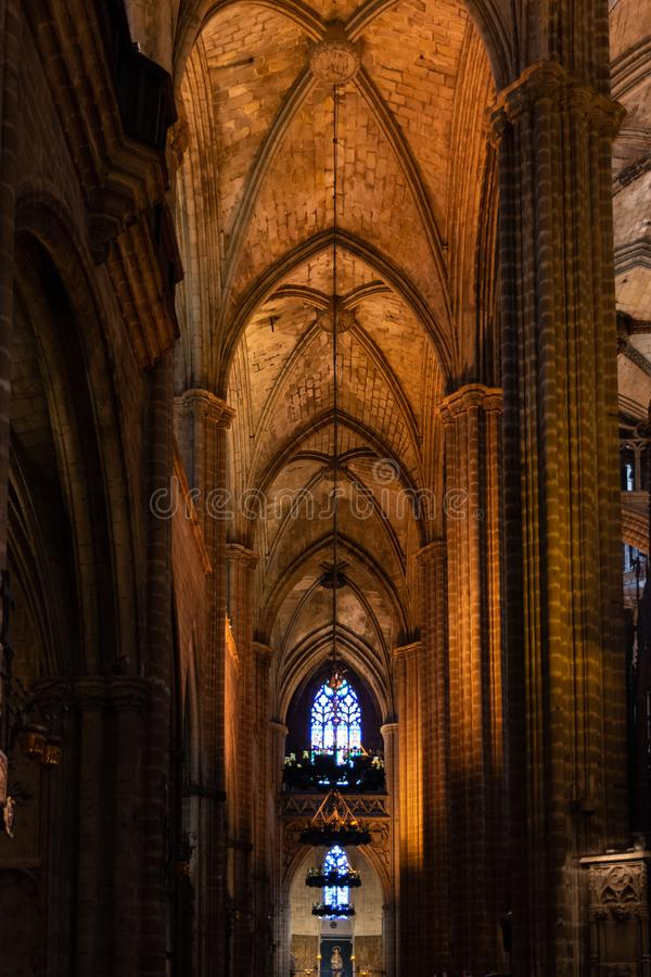 The Cathedral of Barcelona, detail of the lateral nave in typical gothic style with elegant side niches. Barri Gotic, Barcelona. Spain stock image