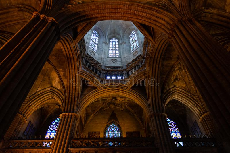 The Cathedral of Barcelona, detail of the main nave in typical gothic style with elegant side niches. Barri Gotic, Barcelona. Spain stock images