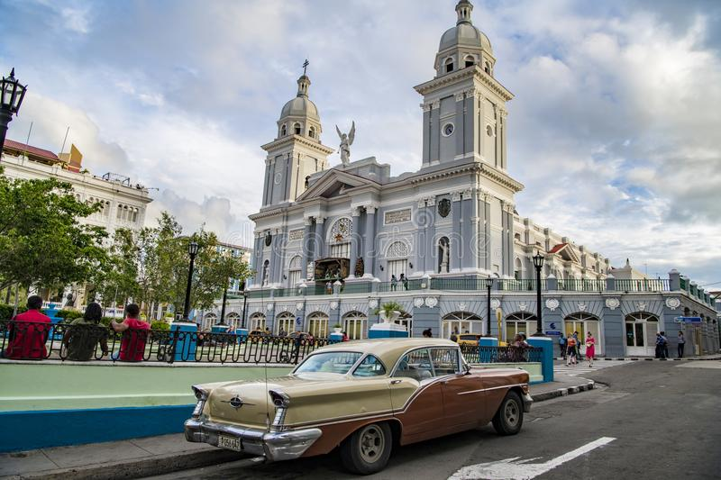 Classic car in front of Cathedral of Santiago de Cuba stock photography