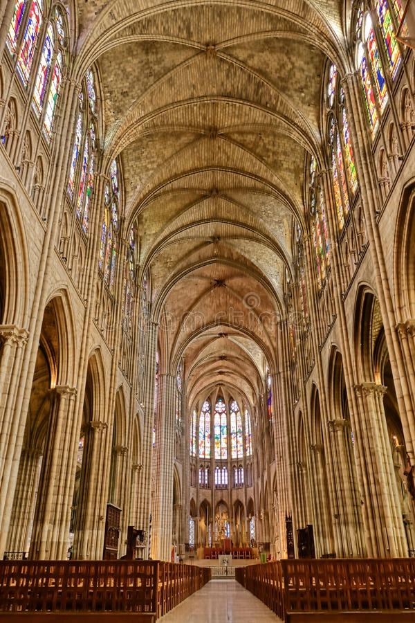 Cathedral Basilica of Saint Denis Nave Interior. Cathedral Basilica Royal of Saint Denis French gothic architecture landmark church interior nave view towards royalty free stock photo